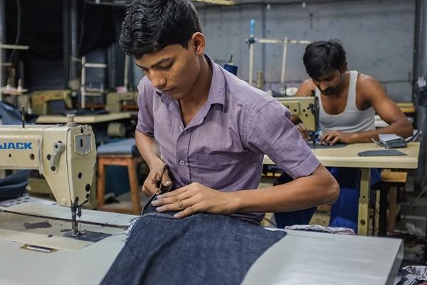 Workers sewing in a clothing factory