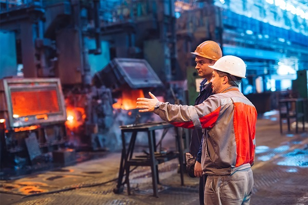 Workers at work in metal factory
